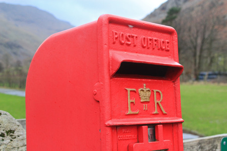 red post box: Isolated British red post box in the countryside representing the far reaches of communication