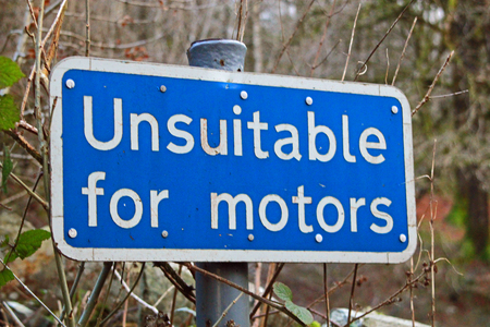 inappropriate: Road sign warning Unsuitable for motors symbolizing roads which do not permit cars and the use of cycles and foot traffic only