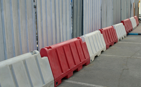 Red and white blocks designating road works, road closures and construction sites