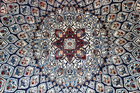 oriental rug: Close up of a Persian rug with abstract symmetrical design