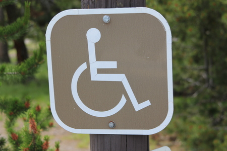 wheelchair access: Sign on a post with a picture of a person in a wheelchair indicating wheelchair and disability access