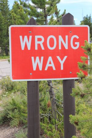 wrong way: Red and white road sign stating WRONG WAY informing traffic not to go down the road the wrong way