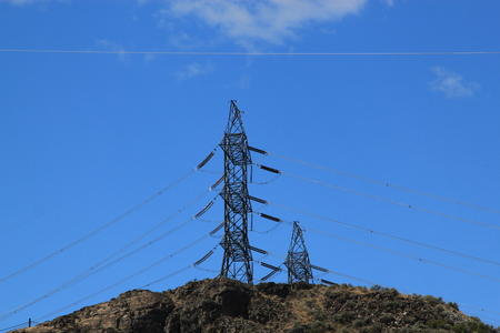 power cables: Electricity pylons and power cables stretching across the countryside