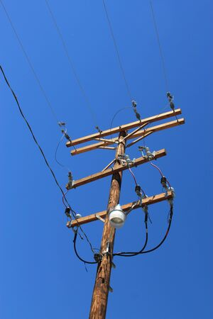 power cables: Close up of an electricity pylon with power cables Stock Photo