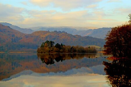synonymous: Mountains in the Lake District, Cumbria, UK, reflected in one of the famous lakes synonymous with the Lake District Stock Photo