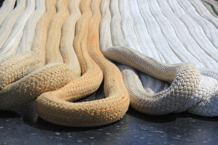 coiled rope: Close up of heavy duty rope laid out in uniform lines showing the textures of the coiled rope Stock Photo