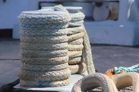 coiled rope: Close up of bollards with coiled textured heavy duty rope