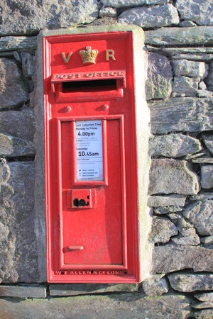 post box: Vintage British Royal Mail red Victorian post box for mailing letters with the letters VR, and the Royal Crown in gold
