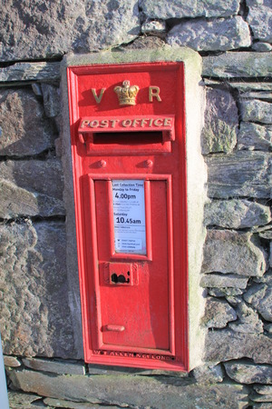 royal mail: Vintage British Royal Mail red Victorian post box for mailing letters with the letters VR, and the Royal Crown in gold