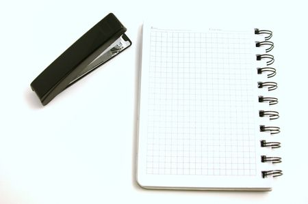 stapler and notebook photo