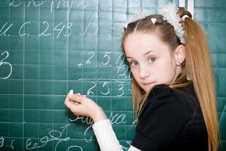 school life: Back to School. Education. Student near Blackboard. School Life.