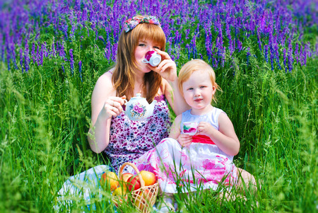 teaparty: Happy Family in Green Grass take a Teaparty. Summer Picnic.