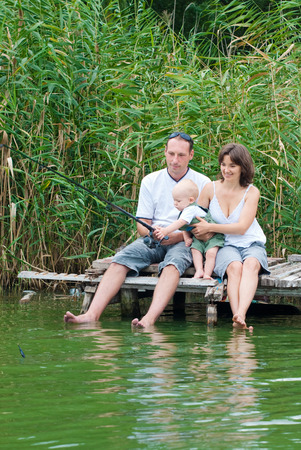 Happy Family Fishing on the Riverside