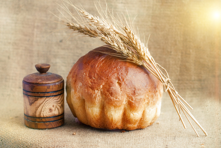 sheaf: Bakery Bread and Sheaf of Wheat Ears. Still-life. Healthy eating