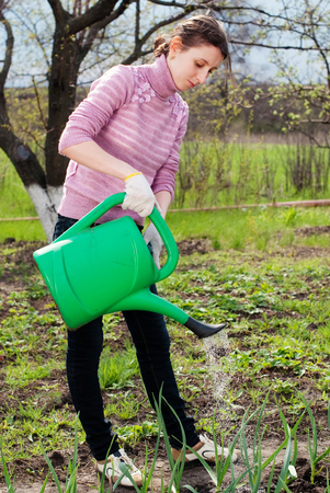tree works: Young Woman working in the Garden. Gardening. Healthy Lifestyle