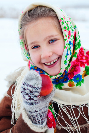 Winter Holidays - Happy winter Vacation at the Countryside. Happy Beautiful Girl in Headscarf. Christmas