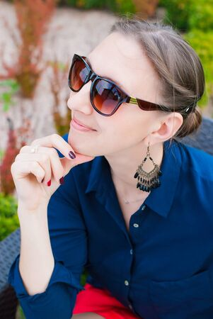 happieness: Romantic Portrait of Young Beautiful Woman in Sunglasses in the Park - Beauty and Fashion Concept