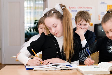 Education concept - School Students at the class Stock Photo