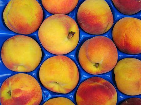 Palette of fresh peaches photo