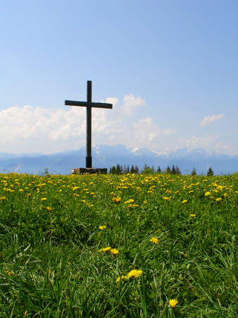 Wooden cross on top of mountain photo