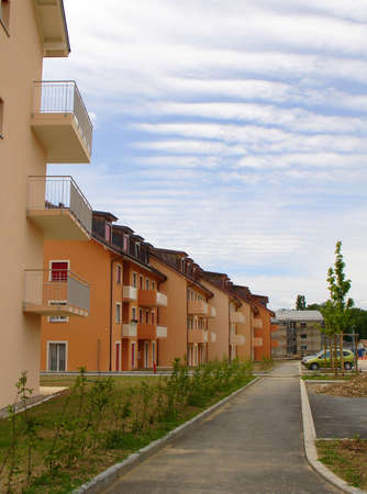 constructed: A road with just build and still constructed houses
