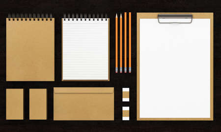 ide: Group of stationery tools on dark wooden background. 3d rendering Stock Photo