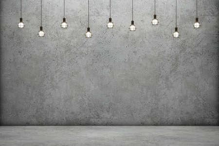 Betonwand und Boden mit leuchtenden Glühbirnen