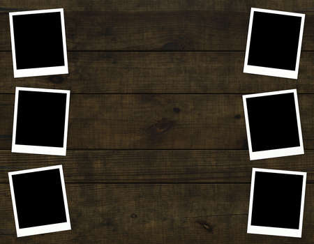 Old photos on distressed wood background Stock Photo