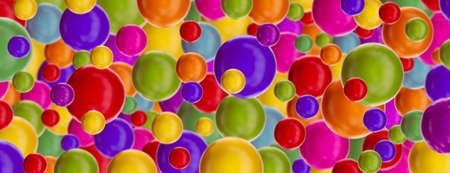 Background with multi-colored glossy balls. 3D rendering