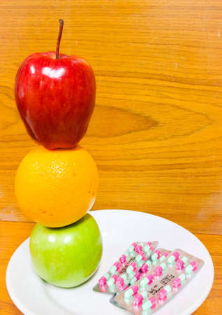 medication and fresh apple Stock Photo - 22876968