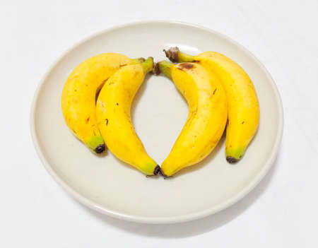Four fresh banana for dinner Stock Photo - 22913873