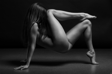 sexy nude women: Beautiful body of young woman over dark background