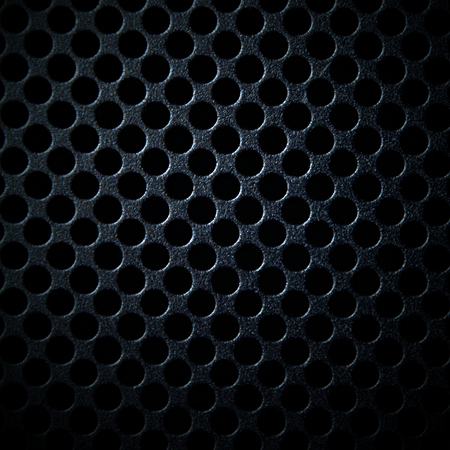 Black metal background with round holes Stock Photo