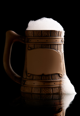 Beer mug on black background Stock Photo
