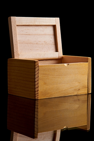 Wooden box on black background