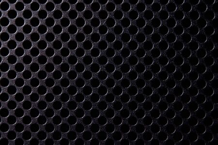 Black metal background with round holes Stock Photo - 22344882