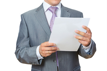 Businessman reading papers on white photo