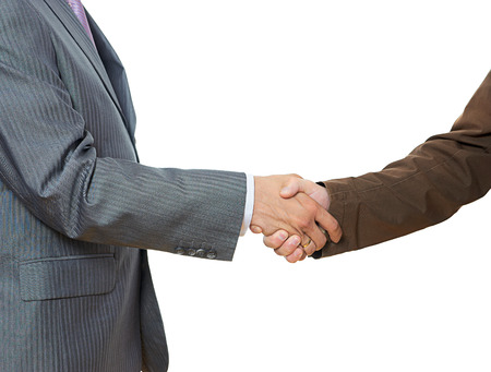 Businessmen shaking hands, isolated on white. photo