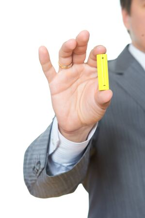 Man holding a yellow battery photo