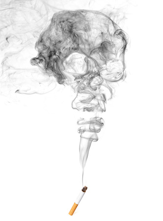 Cigarette And Skull Shaped Smoke Isolated On White Background Stock Photo