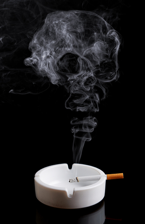 Cigarette in An Ashtray And Skull Shaped Smoke