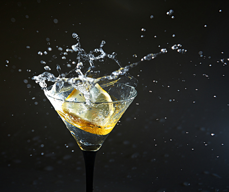 Lemon in coctail with splashes Stock Photo