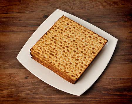 pesakh: matzo (jewish passover bread) on white plate
