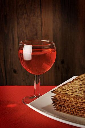 matzo: Wine and matzo (jewish passover bread) on white plate Stock Photo