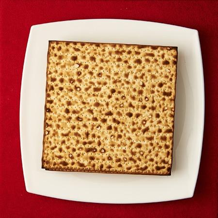 matzos: Matzos (jewish passover bread) on red table