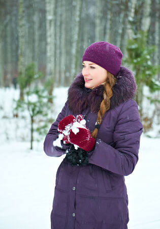 snowball: Young woman playing in snowball fights Stock Photo