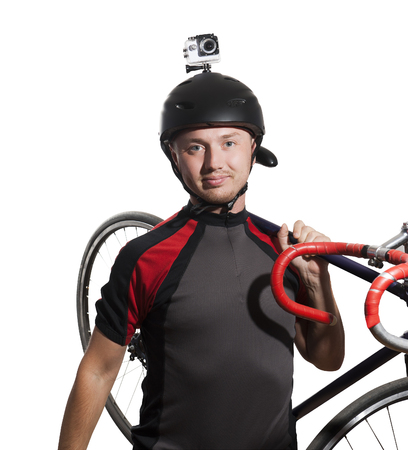 Cyclist with an action camera on his helmet. Isolated on white. Фото со стока