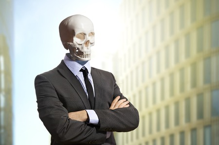 white suit: Skeleton in business suit standing with arms crossed