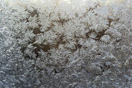 Frost patterns on window glass in winter