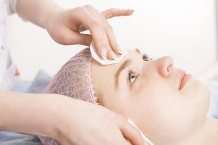 Cleaning face in beauty salon